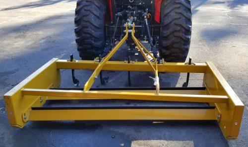 Driveway scraper box grader on tractor