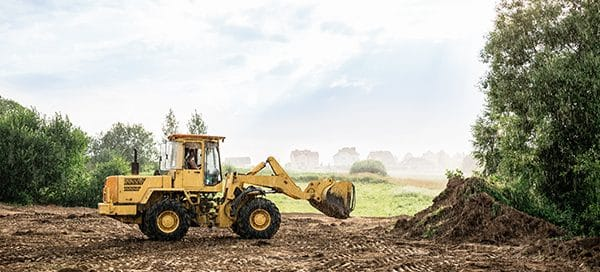 clearing land with a front end loader